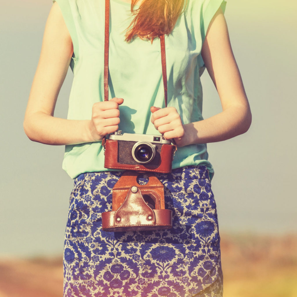 Woman with old-fashioned camera around her neck